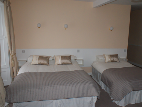 a double and single bed in one of the bedrooms